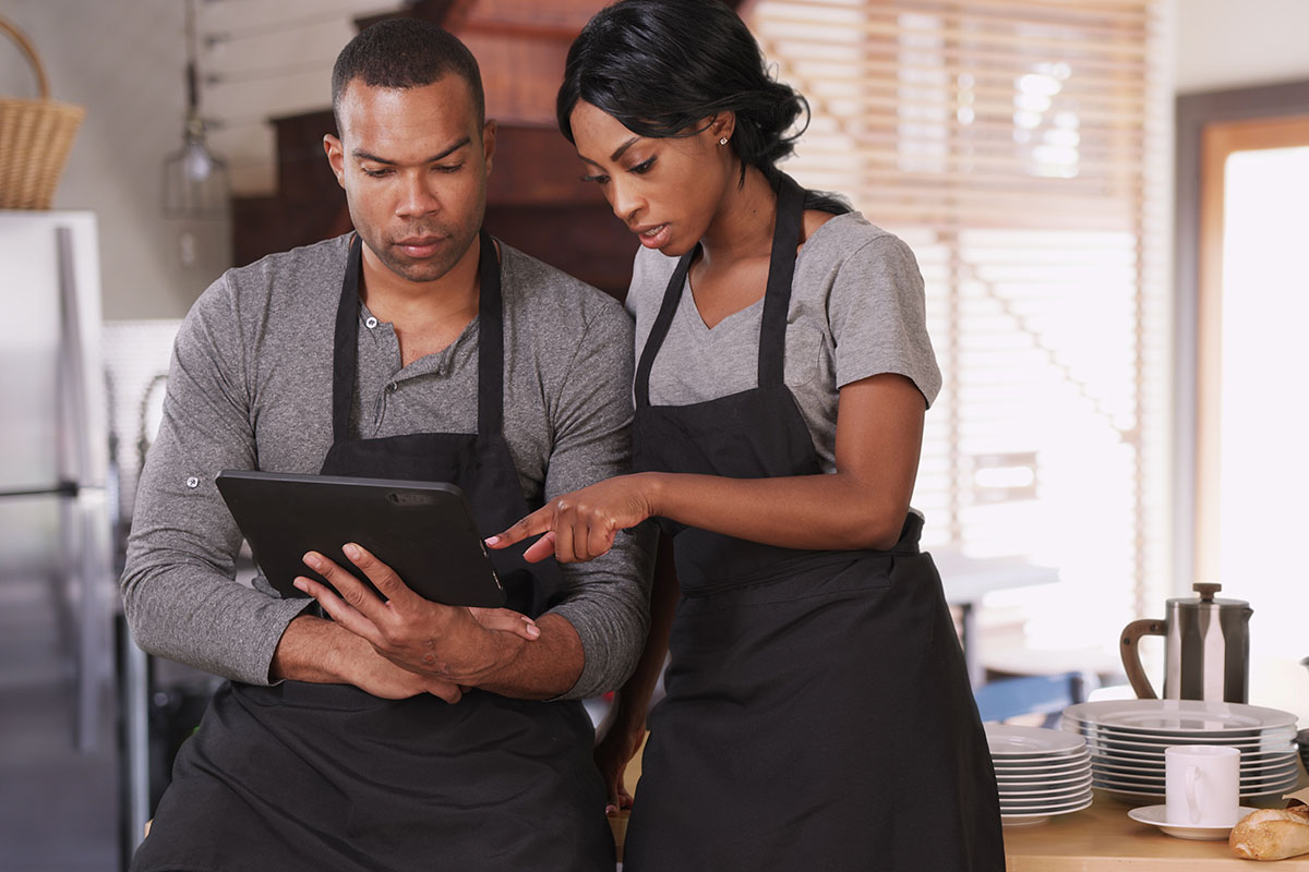 Restaurant Owners Conducting Business